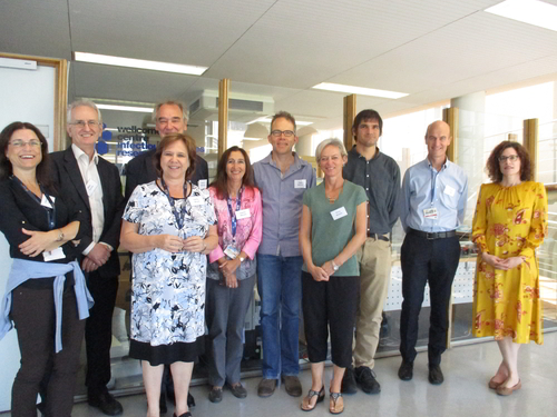 Image of a group of investigators and staff with the Wellcome visitors outside the CIDRI-Africa office