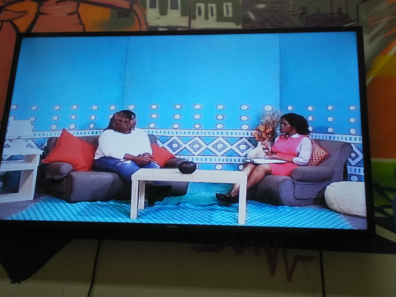 View of a TV showing Khutazwa Madolo and CTV interviewer